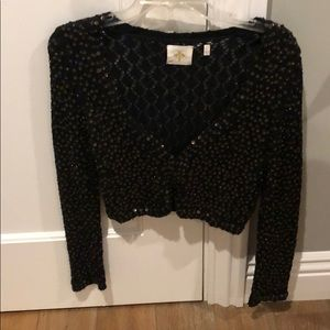 Anthro cropped black sweater with sequin detail.
